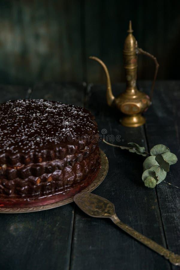 Dark vintage stillife with chocolate cake, stock image