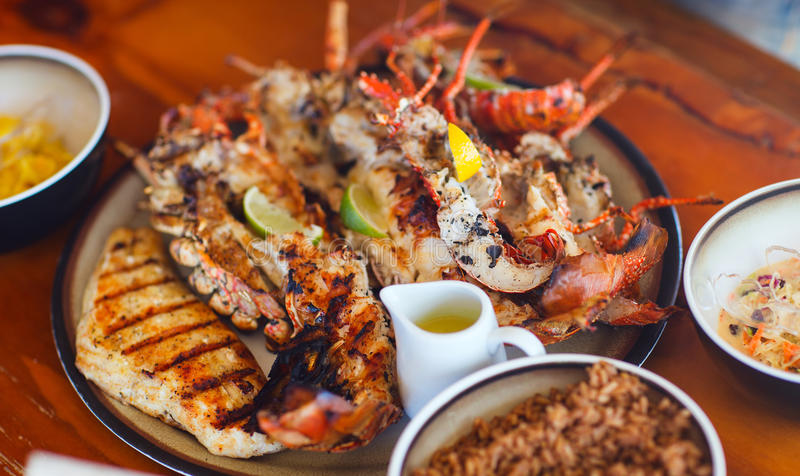 Grilled seafood platter. Close up of delicious grilled seafood platter stock images