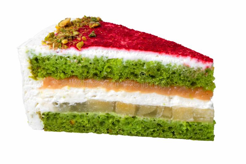 Close-up delicious piece of pink and green cake isolated on white background, pistachio sponge cake with slices of nuts, caramel,. Butter cream and pear stewed royalty free stock photos