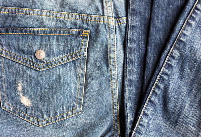 Close up of denim pants or jeans with pocket. Clothes, wear and fashion concept - close up of denim pants or jeans with pocket on white background royalty free stock images