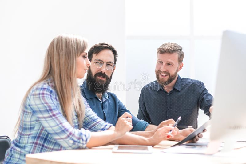 Close up. design team discussing new project. stock images