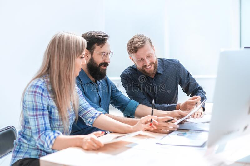 Close up. design team discussing new project. stock photos
