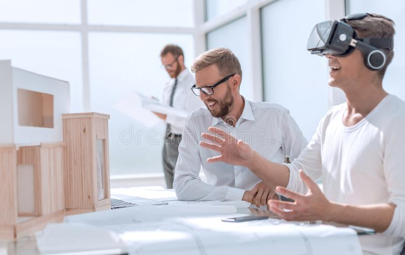 Close up. designer working on the project in VR helmet royalty free stock photos