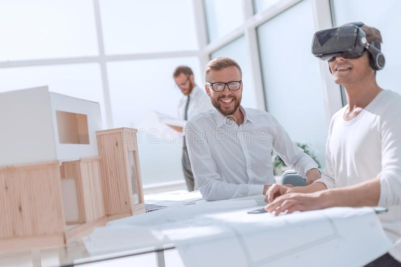 Close up. designer working on the project in VR helmet royalty free stock photography