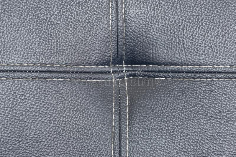 Close up detail black leather with linear stiches. Surface texture background stock photos