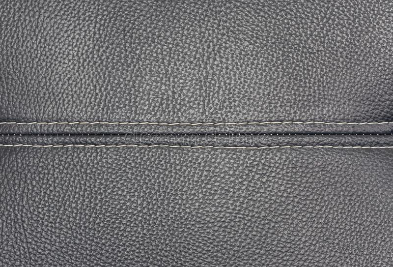 Close up detail black leather texture with linear stiches. Close up detail black leather surface texture background with linear stiches stock photo