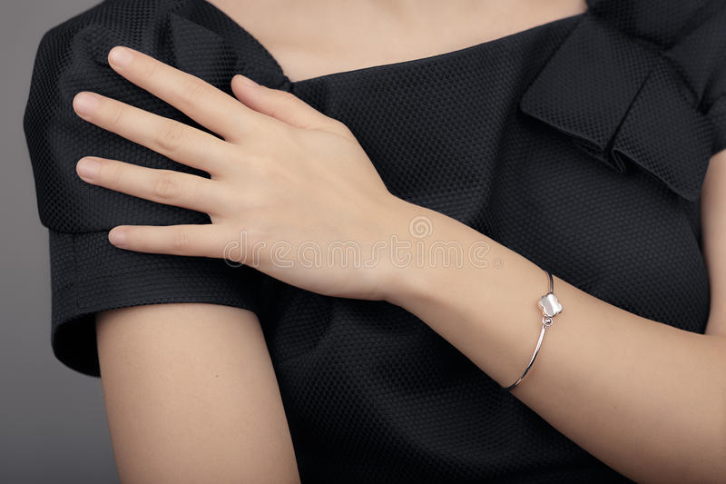 Close up Detail of a Bracelet on a Female Hand Model. Image of a beautiful sparkling fashion accessory bracelet stock images