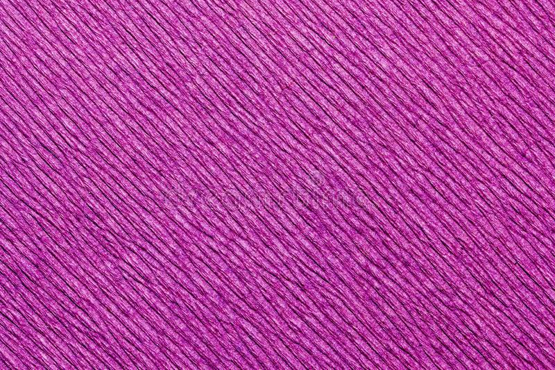Abstract textured background of pink crepe paper stock photography