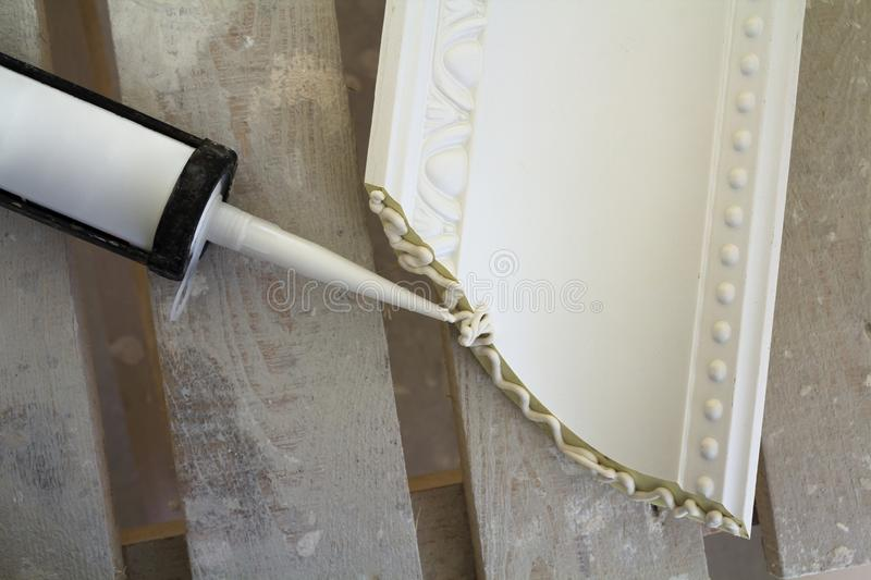 Close-up detail of decoration molding with glue adhesive before installation in interior renovation. Close-up detail of decoration molding with glue adhesive royalty free stock images