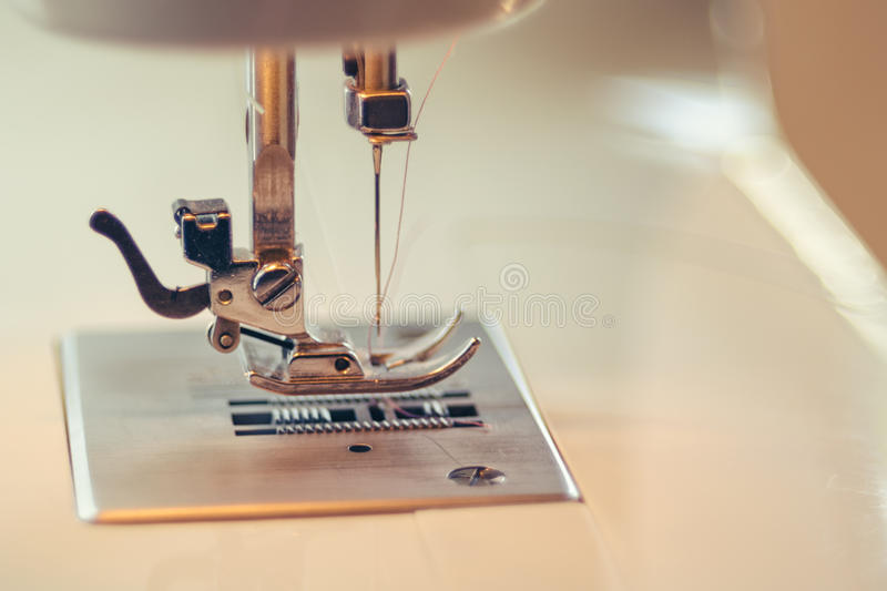 Close-up detail of the Full automatic sewing machine stock photo