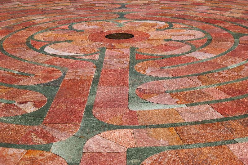 Saint Francis Labyrinth Close-up. A close-up detail of the geometric six petal center of the stone labyrinth in front of the Saint Francis Basilica located in stock photography