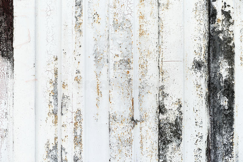 Close-up detail of grunge paint on rusty white metal wall. Close-up detail of grunge paint on rusty white metal wall background stock image