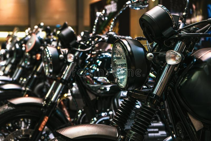 Close up detail of Headlights and chrome parts of motorbikes, brand new motorcycles parked in a row, in a motorbike dealership. stock image