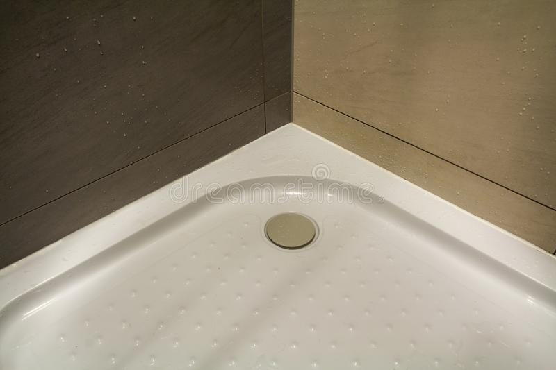 Close-up detail of new modern clean empty white shower cabin wit royalty free stock photography