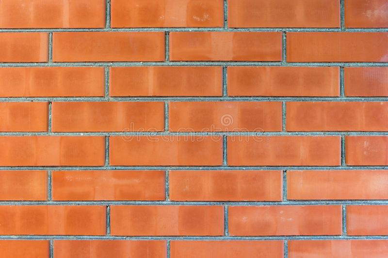 Close-up detail of a red brick wall texture for background. Horizontal brickwork. royalty free stock images