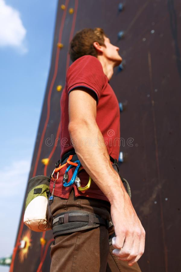 Close-up detail of rock climber wearing safety harness and climbing equipment outdoor wich chalk magnesium bag and royalty free stock photography