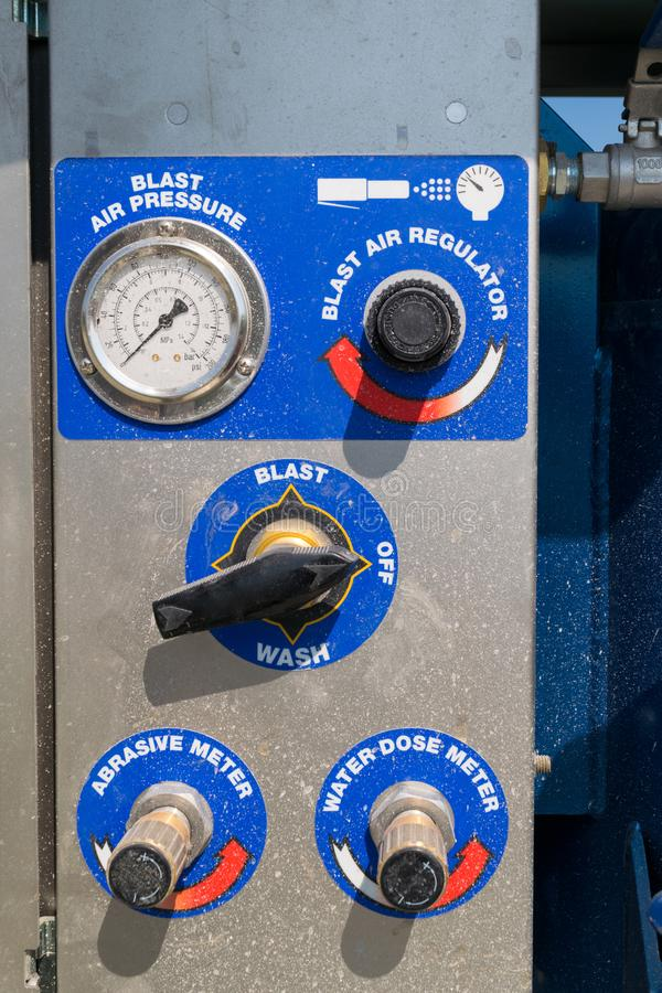 Close-up detail of sandblaster control panel knobs and buttons.  royalty free stock photo