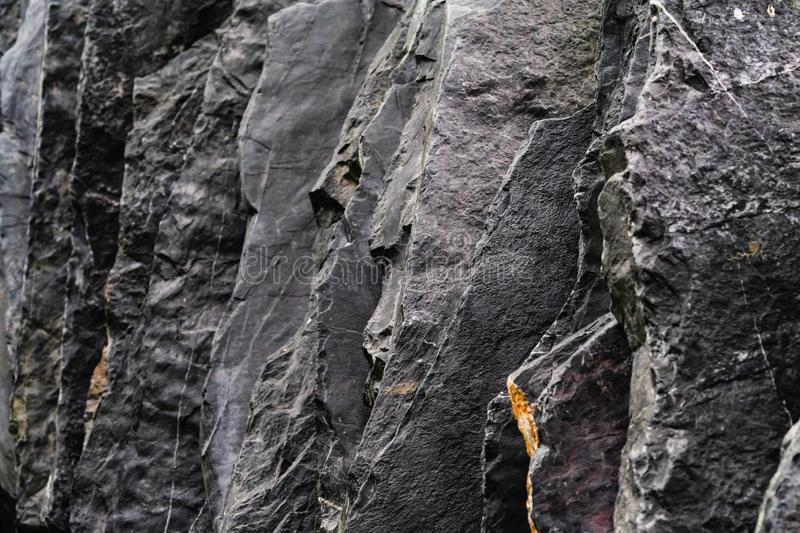 Close up detail shot selective focus of nature of natural dark black slate with gray stone. Construction decoration material royalty free stock photos