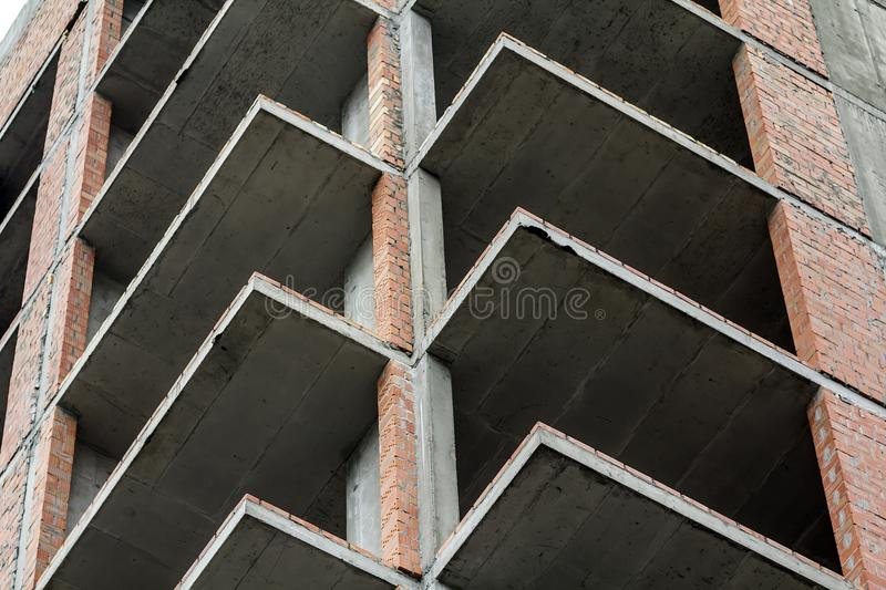 Close-up detail view of a new modern residential house building construction site work under construction. Real estate development. Concept. Multi story home royalty free stock photo