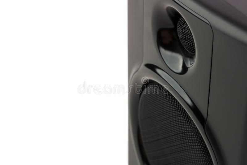 A close up  detail view of a studio speaker in front of a white background. - front view landscape orientation royalty free stock image