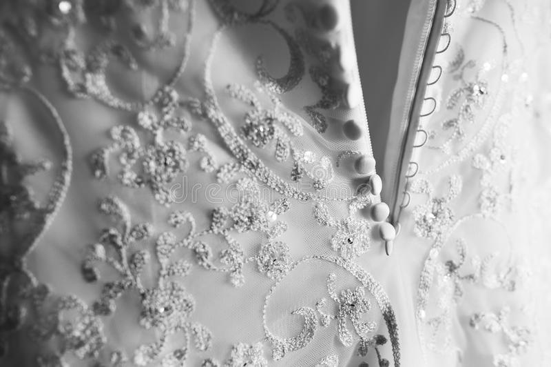 Close-up detail of wedding dress pattern texture. Nice background image stock photo