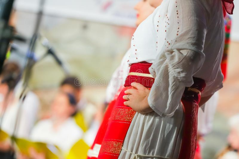 Close up on detail of young Romanian female dancer traditional folkloric costume. Folklore of Romania stock photo