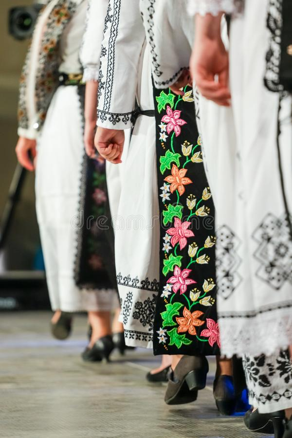 Close up on detail of young Romanian female dancer traditional folkloric costume. Folklore of Romania royalty free stock image