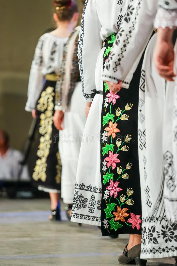 Close up on detail of young Romanian female dancer traditional folkloric costume. Folklore of Romania royalty free stock images