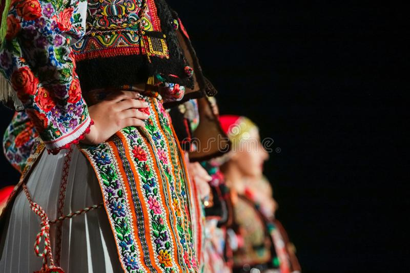 Close up on detail of young Romanian female dancer traditional folkloric costume. Folklore of Romania stock image