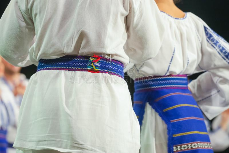 Close up on detail of young Romanian male dancer traditional folkloric costume. Folklore of Romania stock images