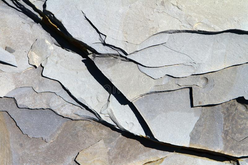 Close up detailed stone surface texture with cracks. Sea limestone. stock photos