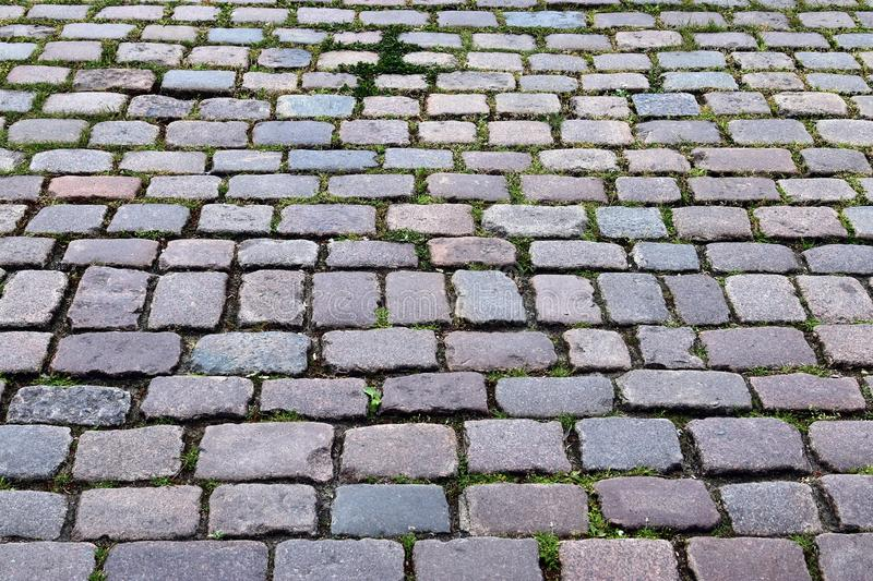 Close up detailed view on a cobblestone street pavement in high reoslution. Found in germany stock images