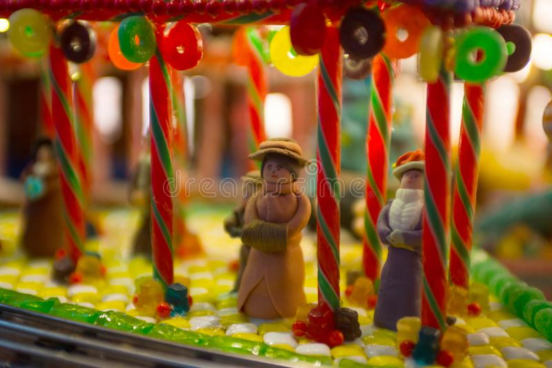 Close-up details of gingerbread Christmas scenery with human fig stock photo