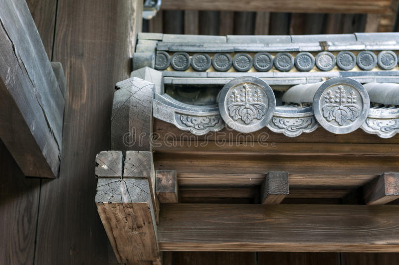 Close up details of Hanagawara or roof tile ornamentation with floral and plant designs in traditional Japanese architecture.  royalty free stock photo