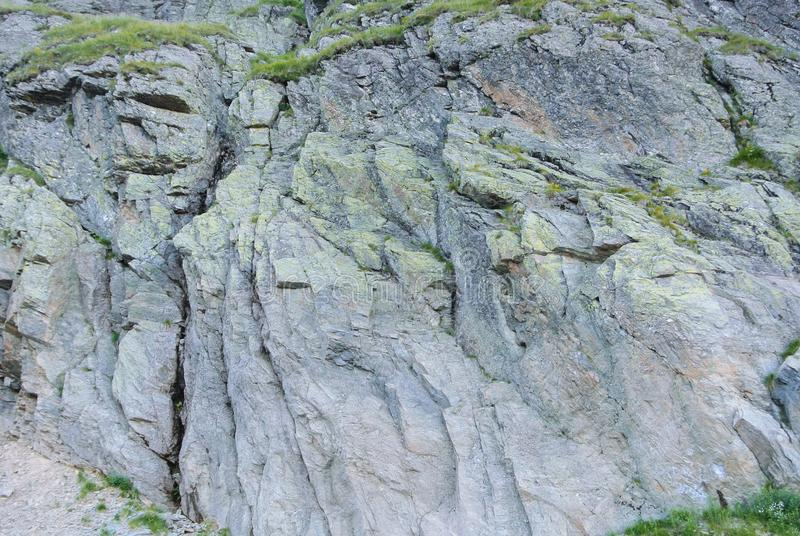 Close up of details of natural rock cut texture and green alpine stock photos
