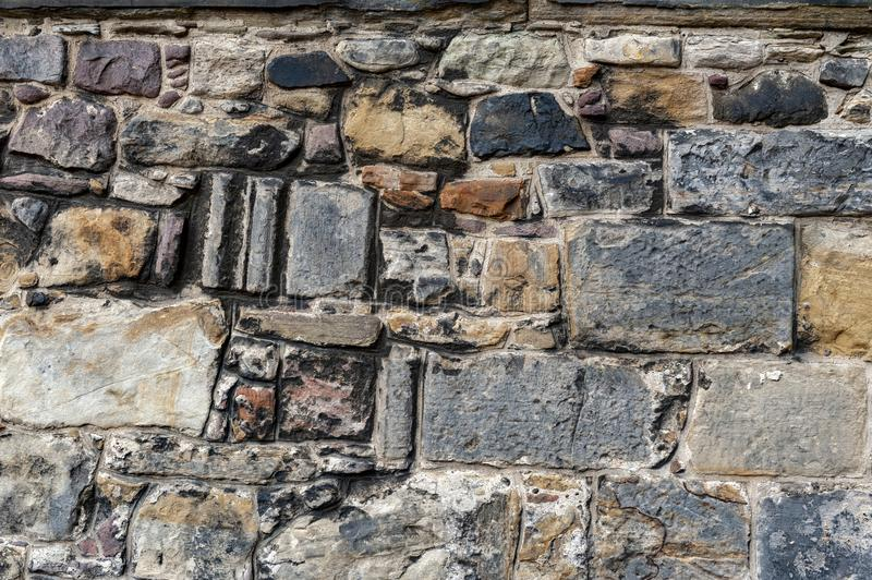 Close up details pattern of background texture of stone brick wall on ancient fortress building from medieval architecture royalty free stock image