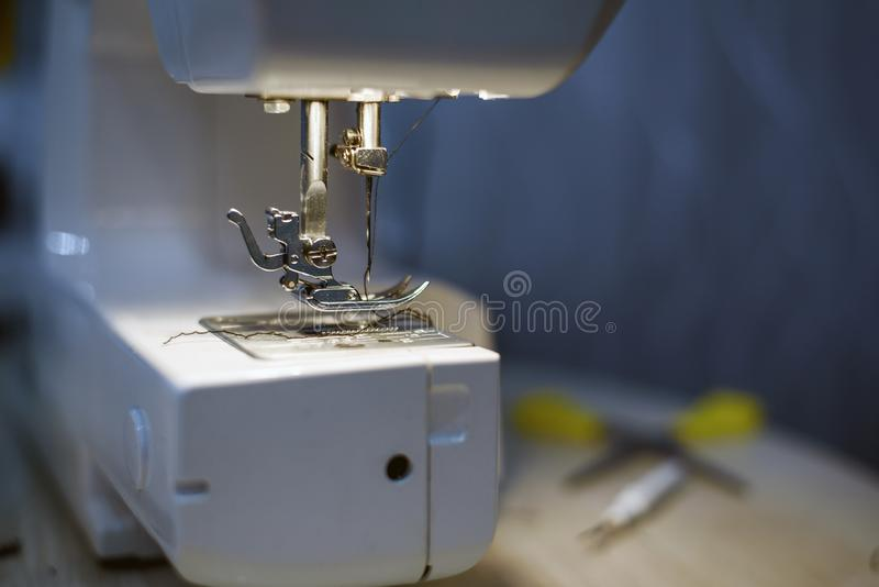 Close-up details with sewing machine needle. needlework concept royalty free stock images