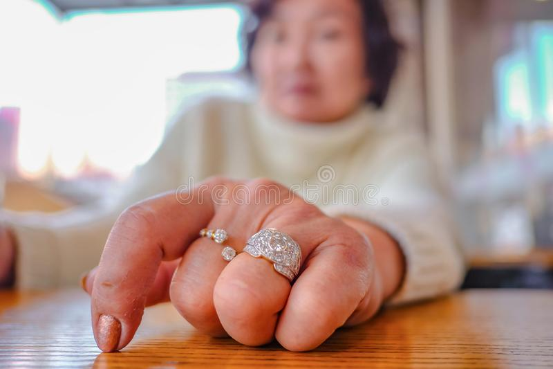 Close up Diamond Ring on Senior women hand. Hand model stock images