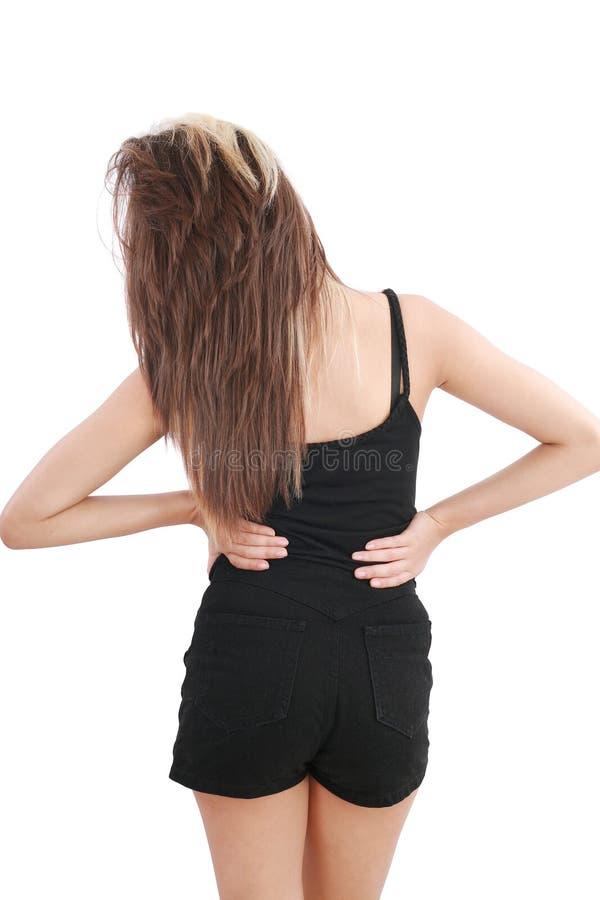 Close-up die van jonge vrouw aan rugpijn lijdt stock fotografie