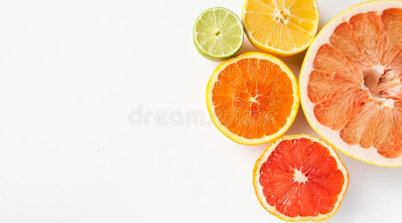 Close-up of different citrus fruits - Myers lemon, lime, mandarin, grapefruit and pomelo. stock photo