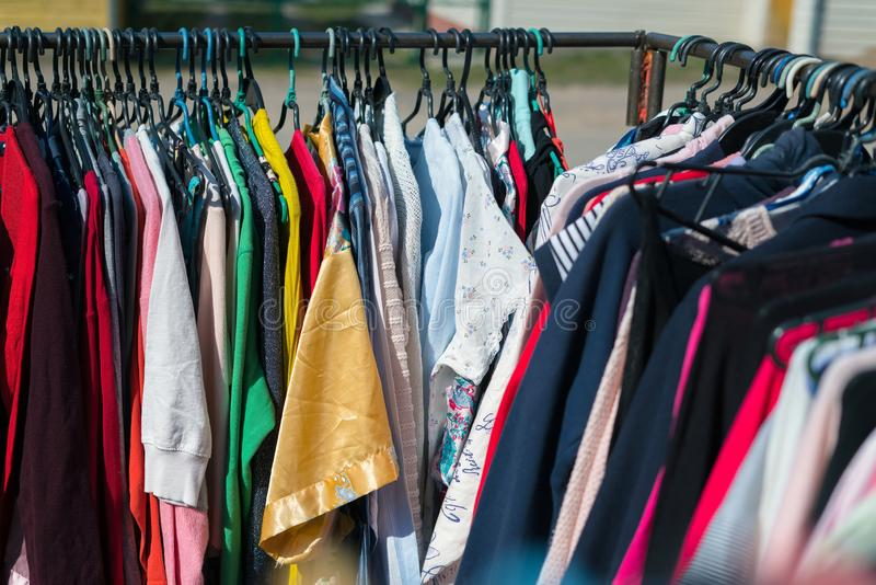 Close up of different clothing textures hanging at street market.  stock image