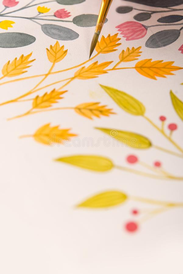 Side view of artist drawing flowers design at workplace. Close up of different colorful flowers nature design painted with brush and watercolors on paper stock photos