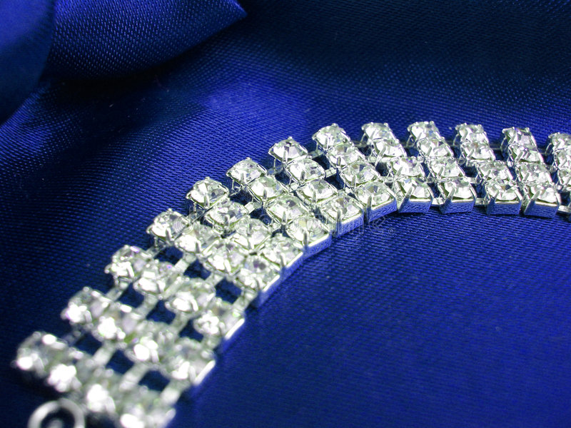 Close up of dimond necklace on a blue background royalty free stock photo
