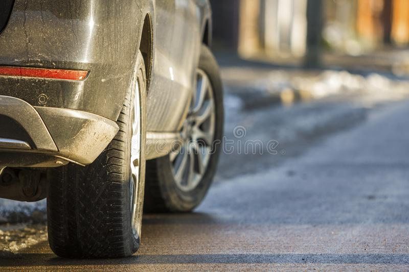 Close-up of dirty car parked on a side of the street stock images