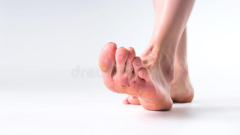 Close up dirty feet grey background royalty free stock photo