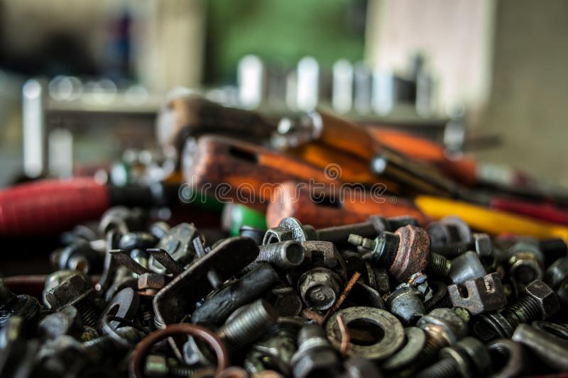 Close up dirty oil tool in the Car factory, steel tool in the industrial. Fix tool the car in the factory stock image