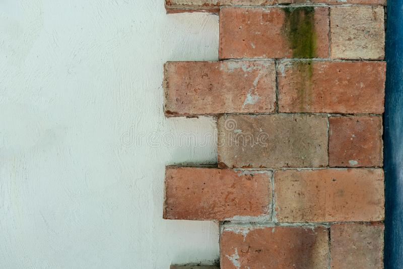 Close up on dirty orange brick wall for texture and background. Abstract pattern in horizontal royalty free stock photos