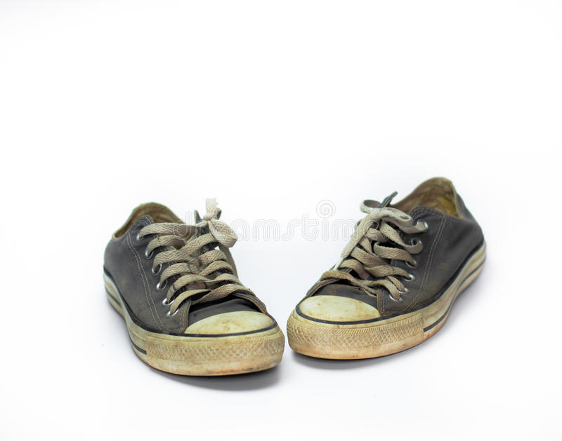 Close up Dirty shoe on isolate white background , close up shoe,dirty blue shoes on the white background , canvas blue shoes ,old royalty free stock photos