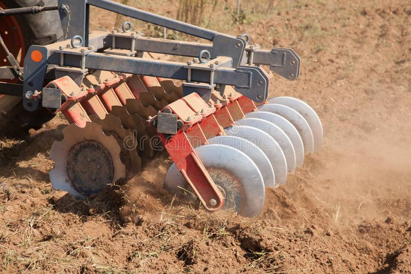 Close up of a disc harrow system, cultivate the soil. Agriculture stock images