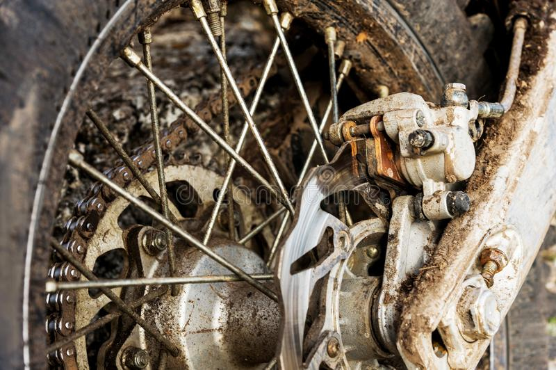 Close-up disc rear brakes of off-road enduro motorcycle royalty free stock images
